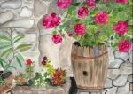 rote Hortensien im Holzfass