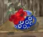Mohnblüte in der blauen Tasse